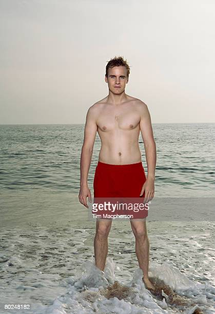 man wearing a swimming costume. - swimwear stock pictures, royalty-free photos & images
