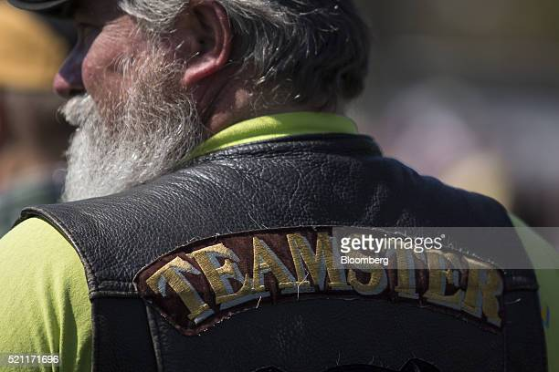 A man wearing a Teamsters jacket attends a rally with retired members of the International Brotherhood of Teamsters and their supporters outside the...