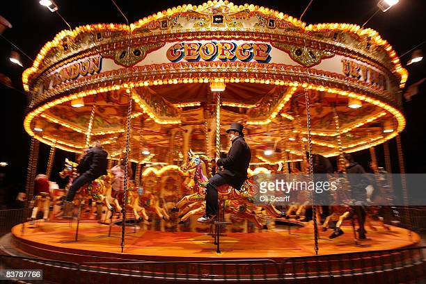 A man wearing a top hat rides the traditional carousel set up in Hyde Park on the first day of the 'Winter Wonderland' experience on November 22 2008...