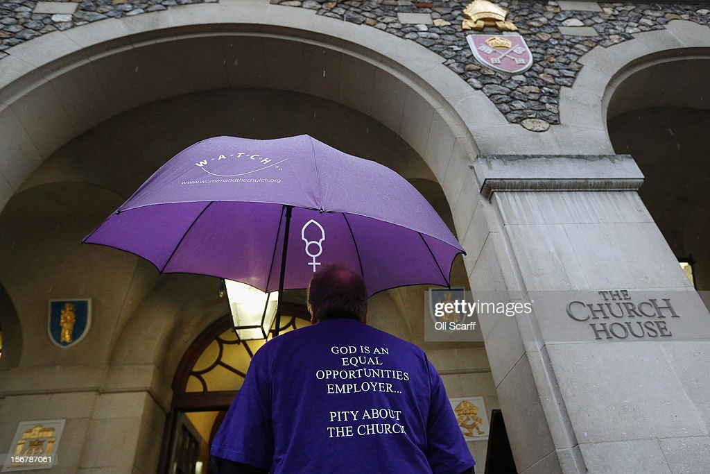 A man wearing a t-shirt campaigning for women bishops arrives at Church House on November 21, 2012 in London, England. The Church of England's governing body, known as the General Synod, yesterday voted to prevent women from becoming bishops.
