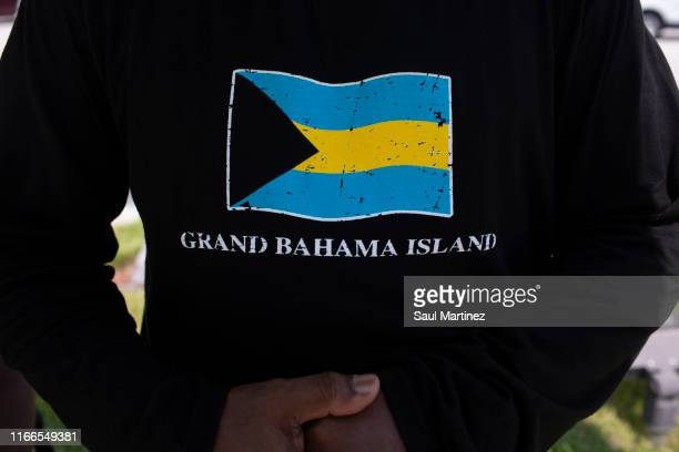 A man wearing a tshirt of the Bahamas at the Port of Palm Beach on September 7 2019 in West Palm Beach Florida The ship arrived with hundreds of...