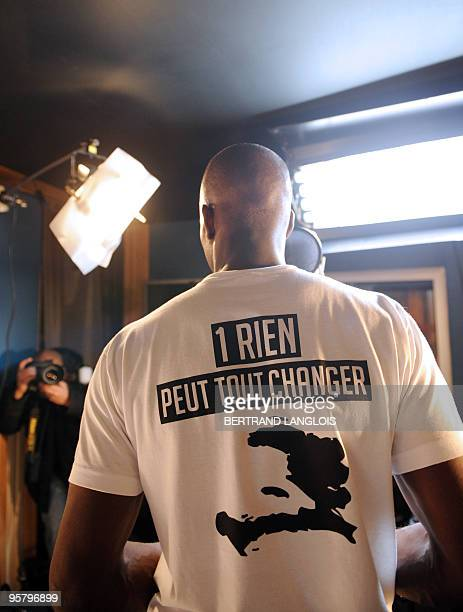 A man wearing a Tshirt reading 1 nothing can change everything is pictured in a music studio in Paris while a dozens of French rappers and pop stars...