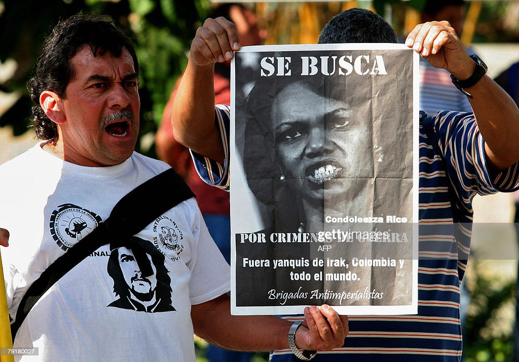 A man wearing a T-shirt with the picture of revolutionary leader Ernesto 'Che' Guevara, demonstrates against the visit of US Secretary of State Condoleezza Rice 23 January 2008 in Medellin, Antioquia department, Colombia. Rice will arrive to Colombia Thursday for a 24-hour official visit. The sign reads 'Wanted, Condoleezza Rice for war crimes. Yakees out of Irak, Colombia and all the world. Anti imperialist brigade'. AFP PHOTO/Raul ARBOLEDA
