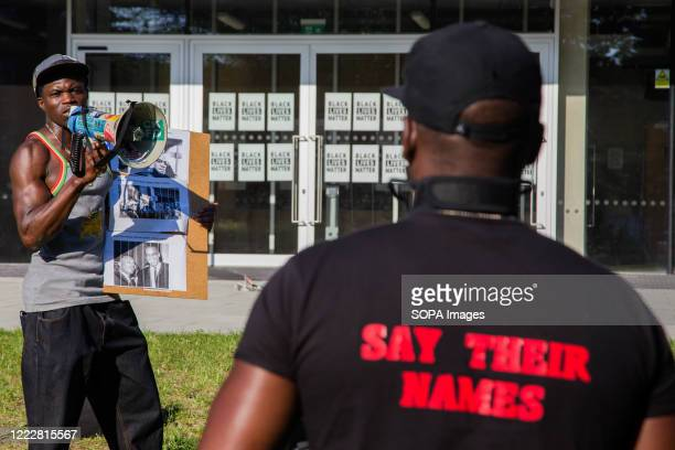 A man wearing a Tshirt with the slogan say their names as people recite the names of those who have died in police custody There is a campaign to...