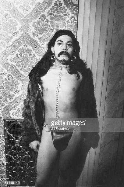 A man wearing a wig and fake moustache poses at a Halloween party in Midtown Manhattan New York City 1973