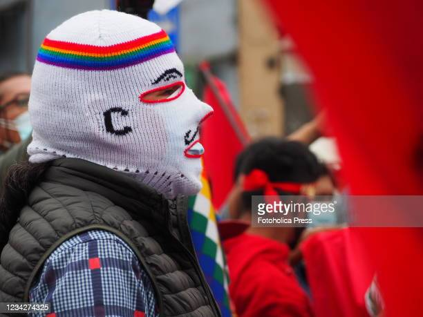 Man wearing a woolen white mask with the a rainbow strip when on the day of Pedro Castillo's presidential inauguration his supporters take to the...