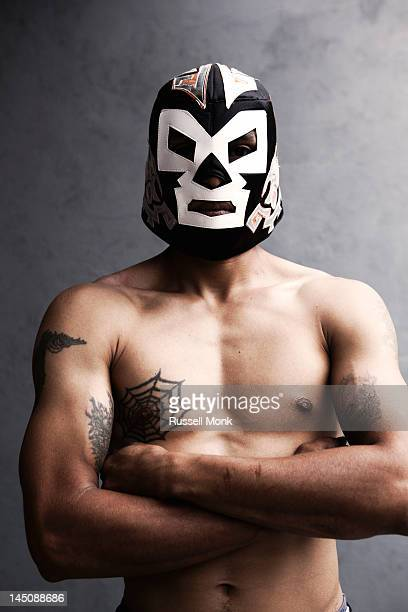 Man wearing a wrestling mask