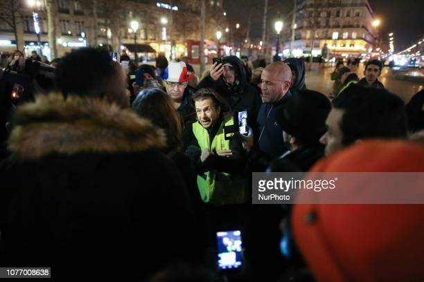 A man wearing a yellow vest speaks to the press during a gathering of the quotYellow Vestsquot place de la Republique in Paris on January 3 in...