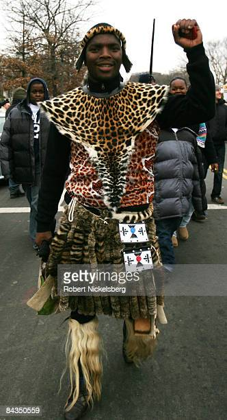 A man wearing African dress walks around the Mall on January 18 2009 in Washington DC President Elect Barack Obama will be sworn in as the 44th...