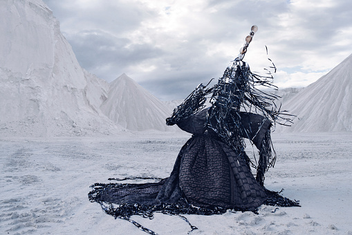 Man wearing amazing costume, made out of old CD's and videotapes - in limestone landscape - gettyimageskorea