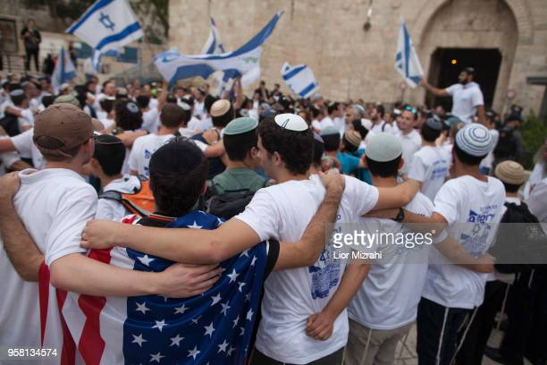Man wearing an American flag dance during a flags march outside Damascus Gate on May 13, 2018 in Jerusalem, Israel. Israel mark Jerusalem Day...