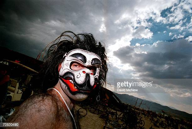 A man wearing an animal mask glances at the camera during the15th annual Burning Man festival September 2 2000 in the Black Rock Desert near Gerlach...