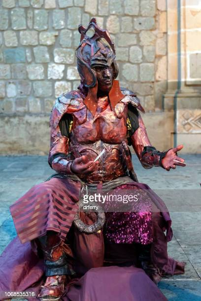 man wearing an aztec costume at the día de los muertos festival in oaxaca - aztec mask stock pictures, royalty-free photos & images