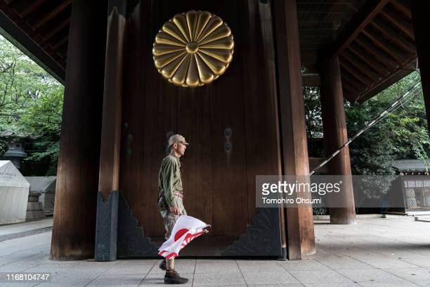A man wearing an Imperial Army uniform visits the Yasukuni Shrine on August 15 2019 in Tokyo Japan Japan marks the 74th anniversary of the end of...