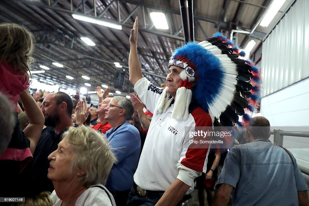 A man wearing an Indian American headdress attends a rally with Republican presidential nominee Donald Trump at the Rodeo Arena at the Jefferson County Fairgrounds October 29, 2016 in Golden, Colorado. The Federal Bureau of Investigation announced Friday it discovered emails pertinent to the closed investigation of Democratic presidential nominee Hillary Clinton's private email server and are looking to see if they improperly contained classified information. Trump said 'I think it's the biggest story since Watergate.'