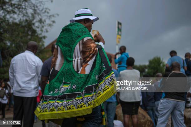 A man wearing ANC flag walks pays tribute to late South African antiapartheid campaigner Winnie MadikizelaMandela exwife of African National Congress...