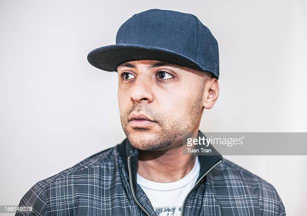Man wearing baseball cap, portrait