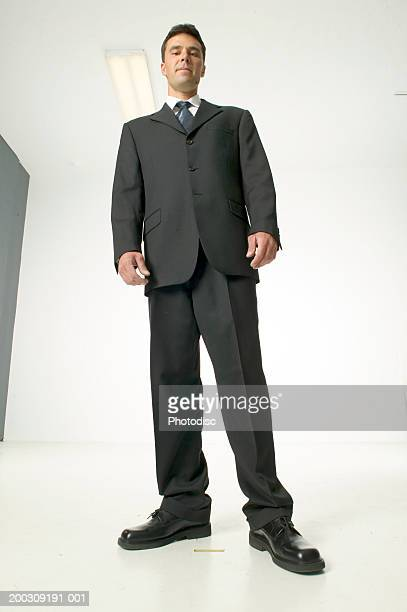 man wearing black, posing in studio, portrait, low angle view - mid adult men stock pictures, royalty-free photos & images