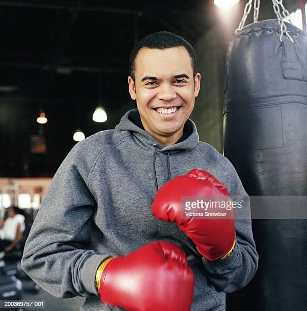 Man wearing boxing gloves in gym