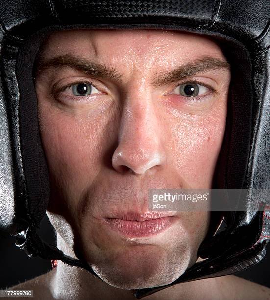 Man wearing boxing  helmet