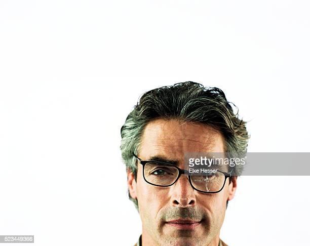 Man Wearing Broken Glasses