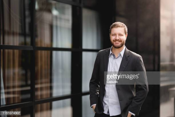 man wearing casual business attire - white blazer stock pictures, royalty-free photos & images