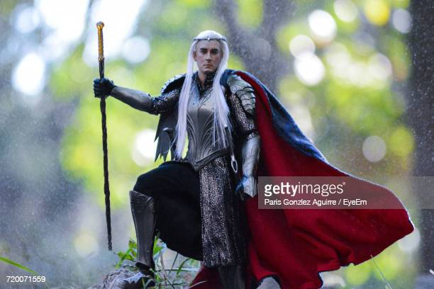 man wearing cosplay costume holding weapon - cosplay stock pictures, royalty-free photos & images