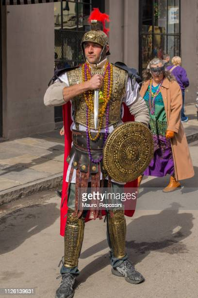 a man wearing costume in the street during the mardi gras celebration at new orleans carnival, louisiana, usa - mardi gras fun in new orleans stock photos and pictures