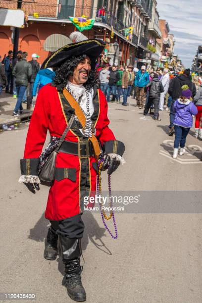 a man wearing costume in the street during the mardi gras celebration at new orleans carnival, louisiana, usa - creole ethnicity stock pictures, royalty-free photos & images