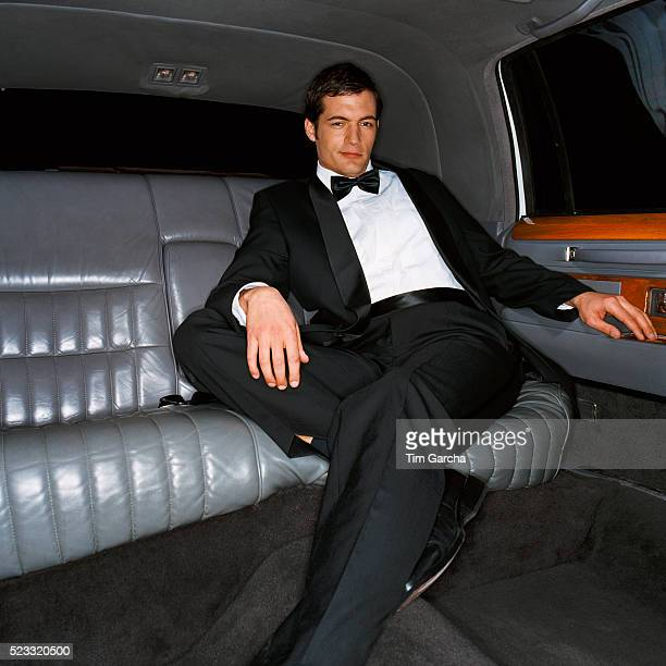 Man Wearing Dinner Jacket in the Back Seat of Limousine
