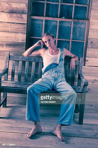 Man Wearing Dungarees And Vest