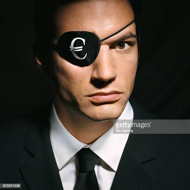 Man Wearing Eye Patch with Euro Symbol