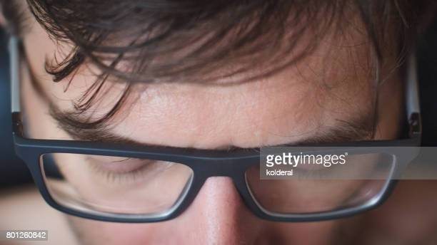 man wearing eyeglasses - eye chart stock photos and pictures
