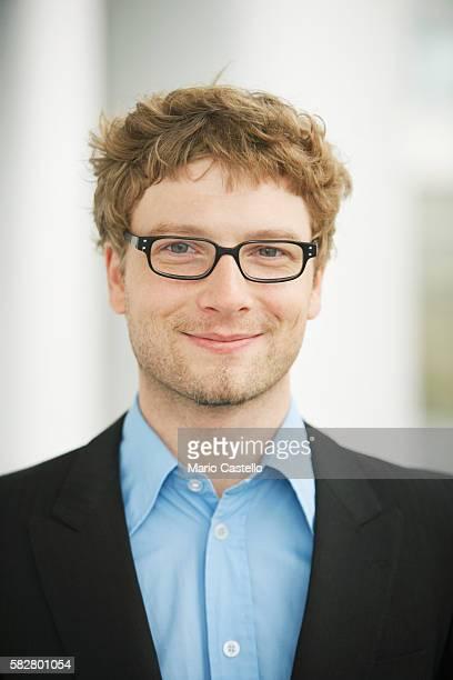 Man wearing eyeglasses, smiling