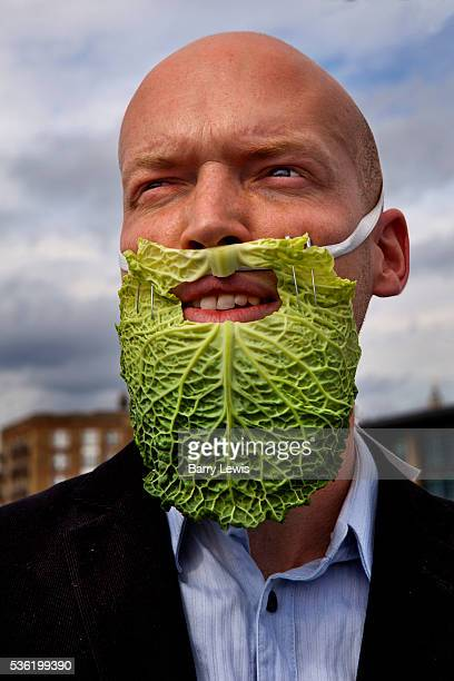 Man wearing false beard made from a cabbage leaf, part of the SOIREE theatre group re-enacting some insignificant historical food-related events at...