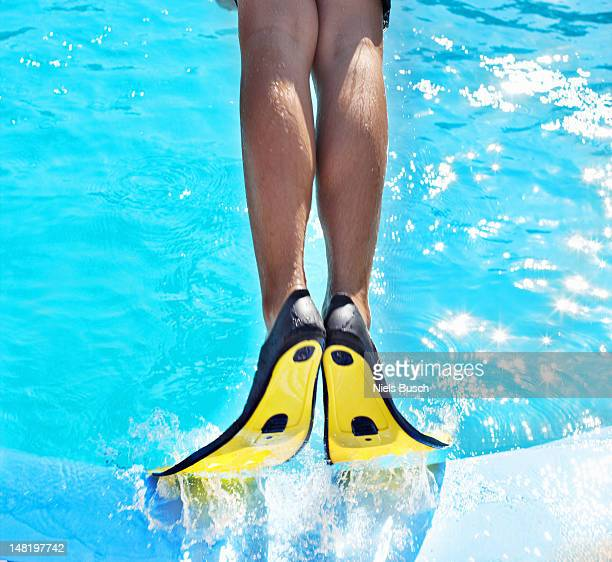 Man wearing fins in swimming pool