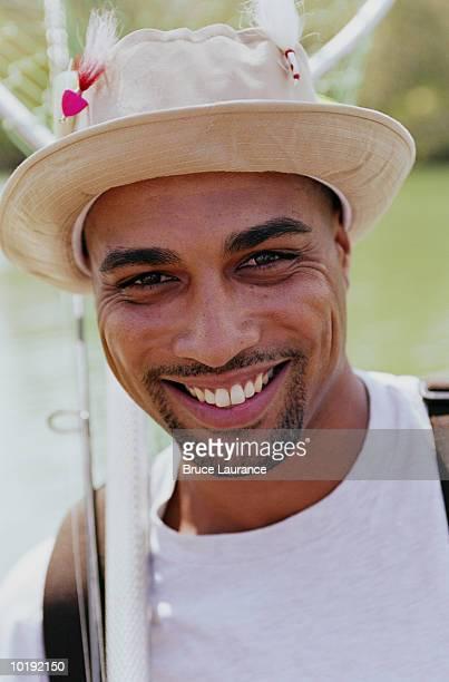Man wearing fishing hat, close up