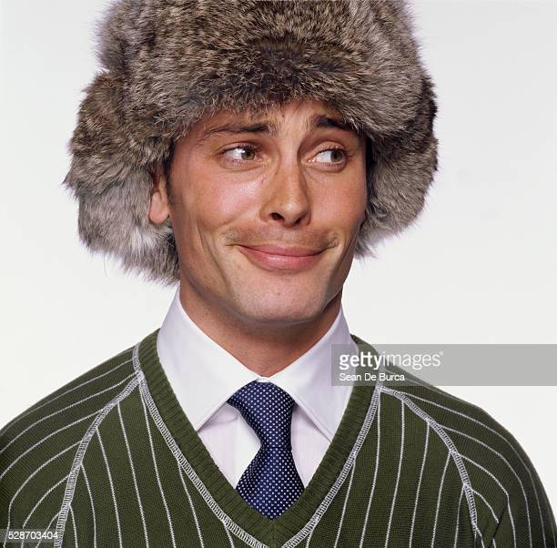 man wearing fur hat - fur hat stock photos and pictures