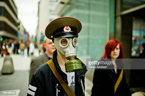 Man wearing gas mask in the street daytime