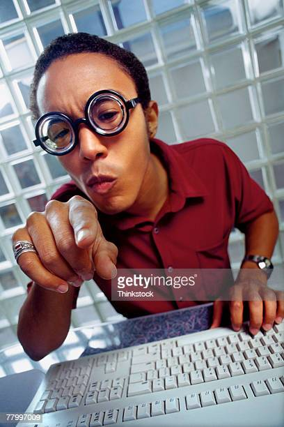 Man wearing glasses with keyboard