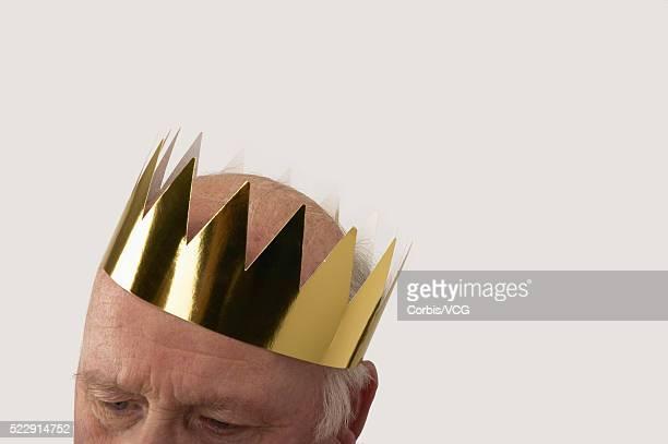 Man wearing gold paper crown