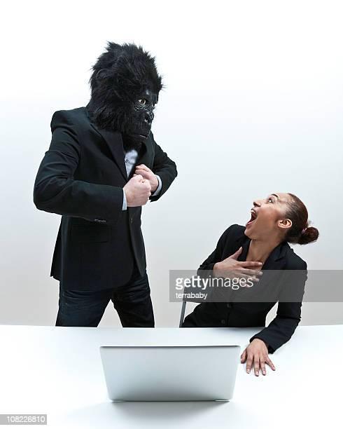 Man Wearing Gorilla Mask and Terrifying Businesswoman