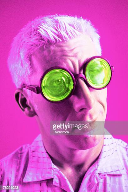 man wearing green glasses - thinkstock stock photos and pictures