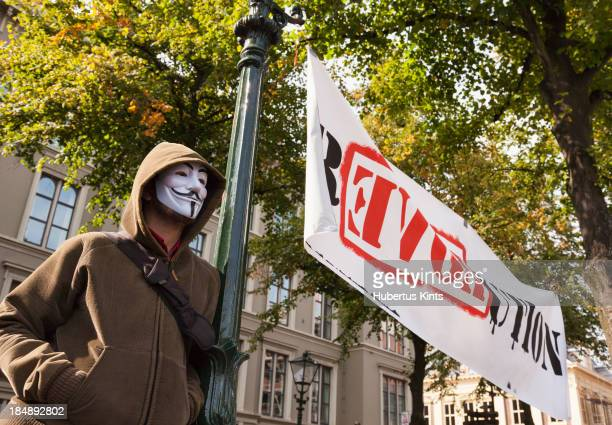 CONTENT] Man wearing Guy Fawkes mask during protest against austerity policy of Dutch Government on September 21 in The Hague The Netherlands