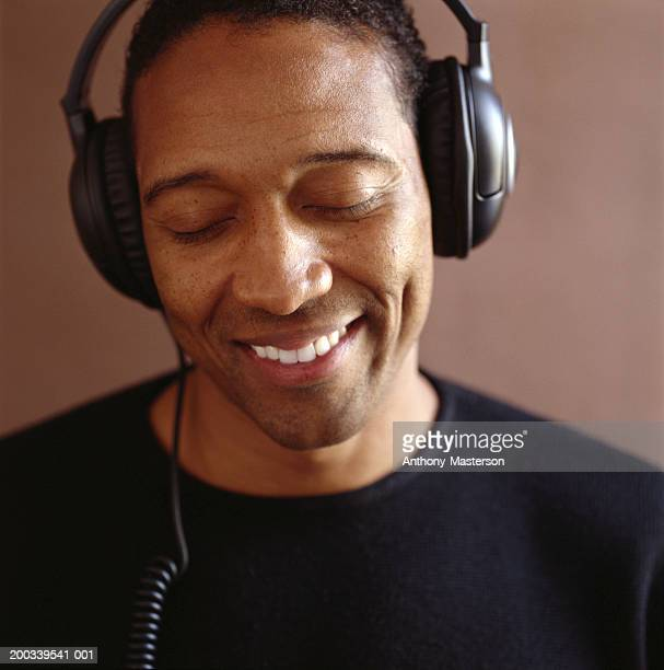 man wearing headphones - anthony-masterson stock pictures, royalty-free photos & images
