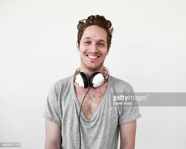 man wearing headphones, smiling - torso stock pictures, royalty-free photos & images