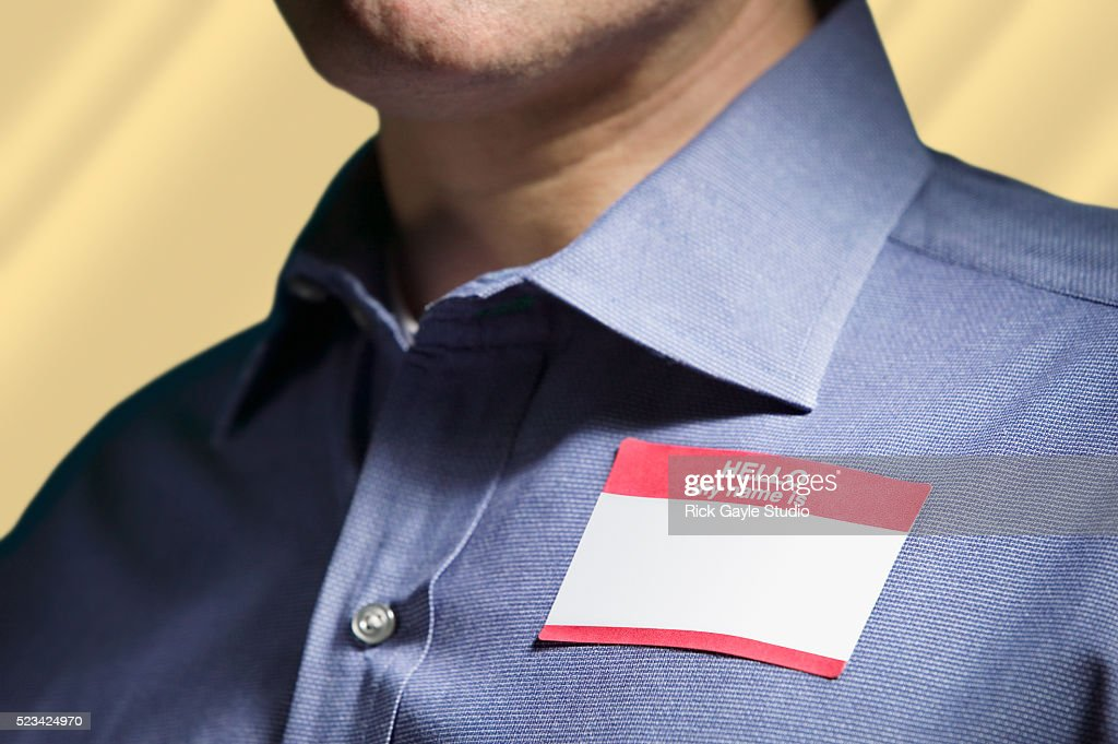 "Man Wearing ""Hello My Name Is"" Tag : Stock Photo"