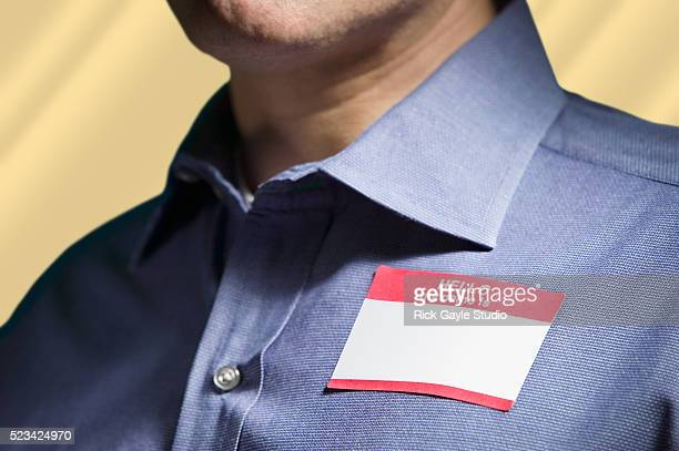 "Man Wearing ""Hello My Name Is"" Tag"