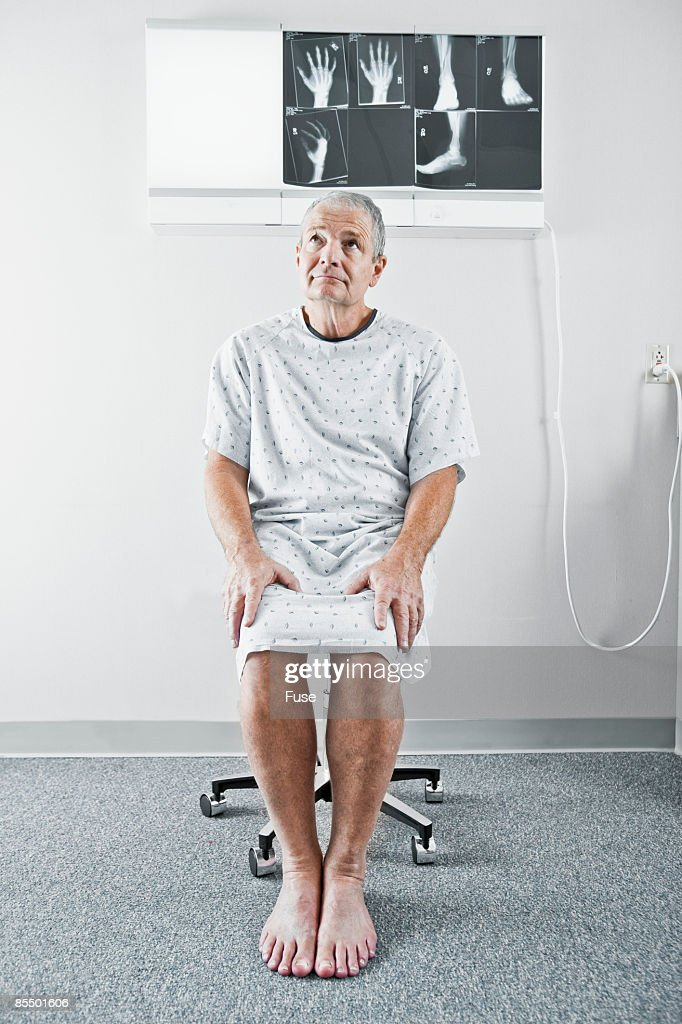 Man Wearing Hospital Gown Stock Photo | Getty Images