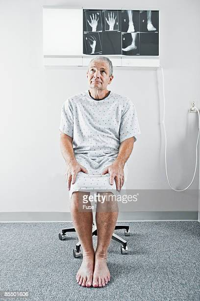 Man Wearing Hospital Gown